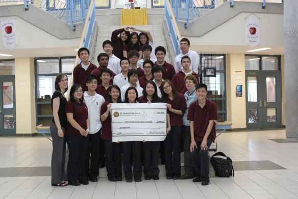 St. Augustine's HEART committee poses with their $10,000 cheque. (Photo courtesy of Bertha Yetman)